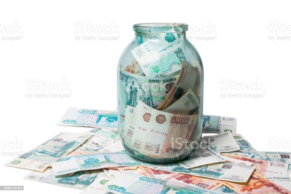One and  five thousand roubles banknotes in the glass jar stock photo