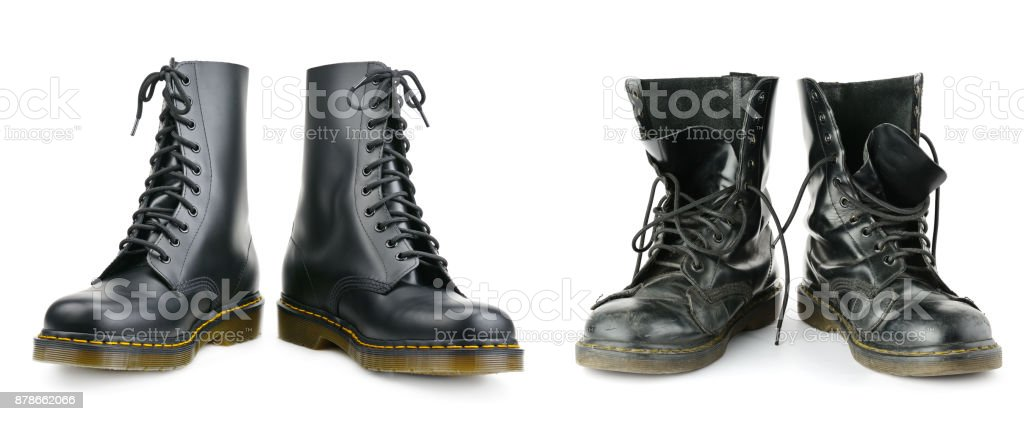 One and the same pair of black men's boots. New and worn out. stock photo