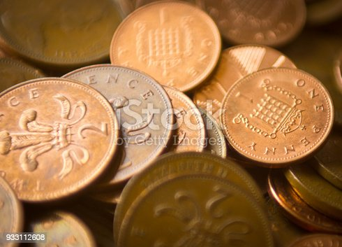 Close up of the copper one pence and two pence coins that are rumored to be withdrawn from circulation. This shows both coins piled up on a dining table.