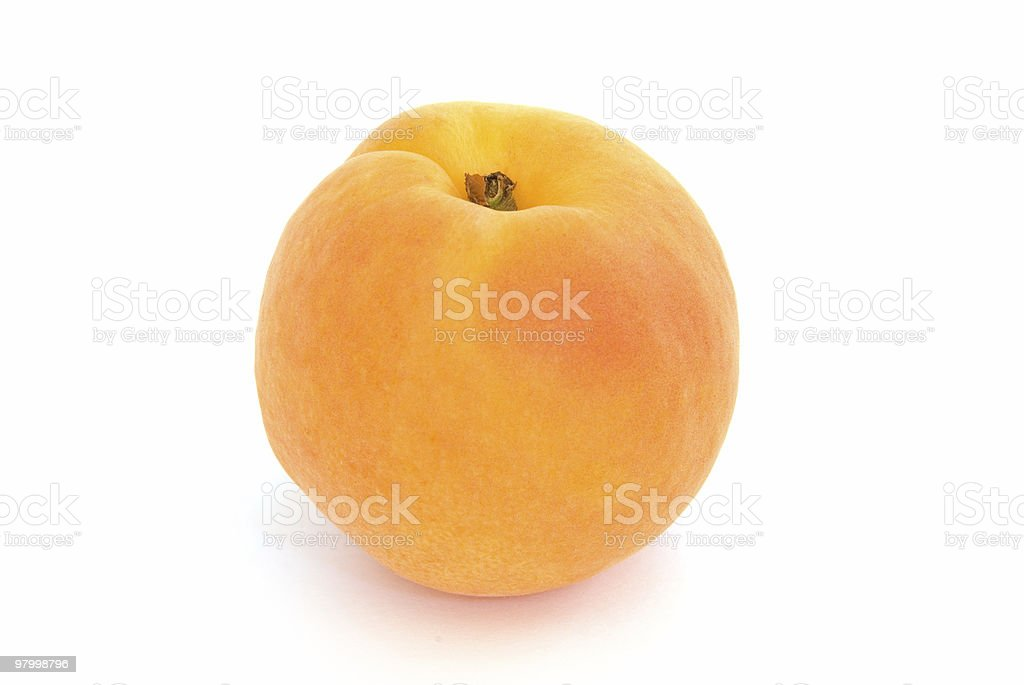 One apricot isolated on white royalty free stockfoto