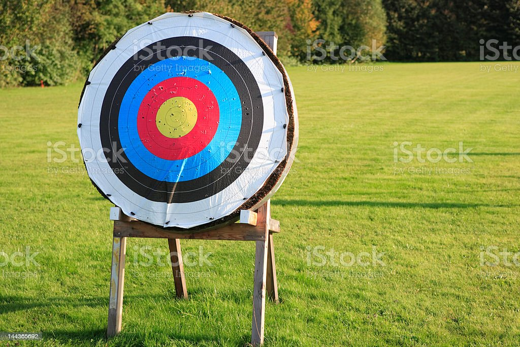 one archery target on green meadow stock photo