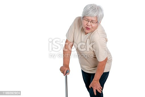 698466046istockphoto One Asian elderly woman express action of knee pain and isolate on white background with copy space 1169392924