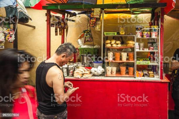 One asian man paying on a street food stall picture id992007604?b=1&k=6&m=992007604&s=612x612&h=yphlamgavjf tqbpgm ssxheya3b0 vik6wiq2mk0bq=