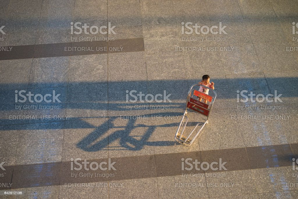 Hanoi, Vietnam - July 12, 2015: One baggage trolley cart at Noi Bai International Airport , the biggest airport in northern Vietnam, has officially opened a new terminal named Terminal 2 (T2) in 2014 stock photo