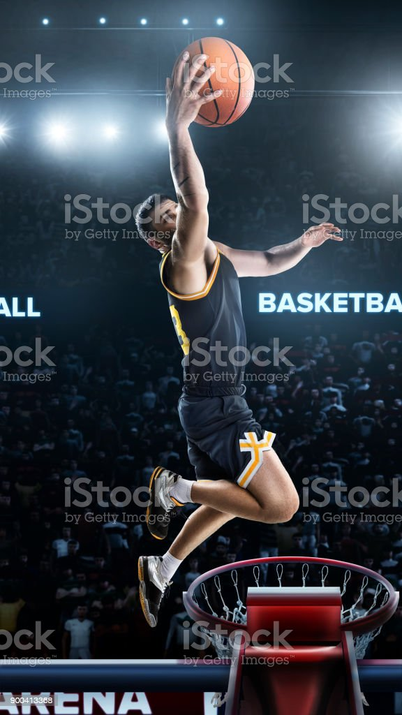 one basketball player jump in stadium panorama view stock photo