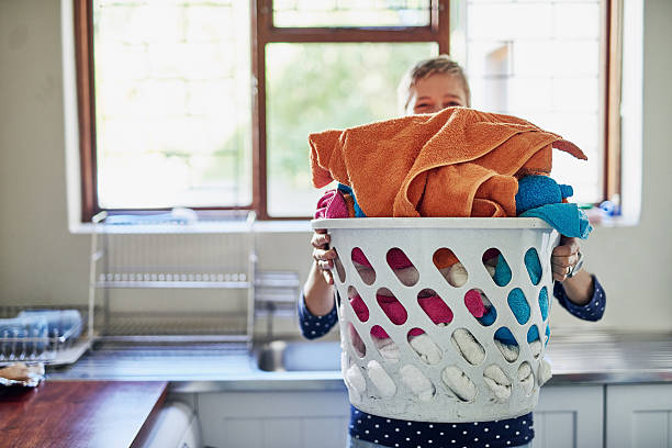 One big pile of laundry Shot of a woman holding a basket of laundry laundry basket stock pictures, royalty-free photos & images