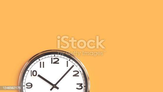 816405814 istock photo One big wall clock top part on orange background 1246562175