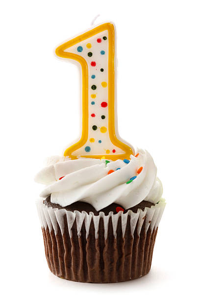 One Birthday Cupcake with Number 1 Candle  first birthday stock pictures, royalty-free photos & images
