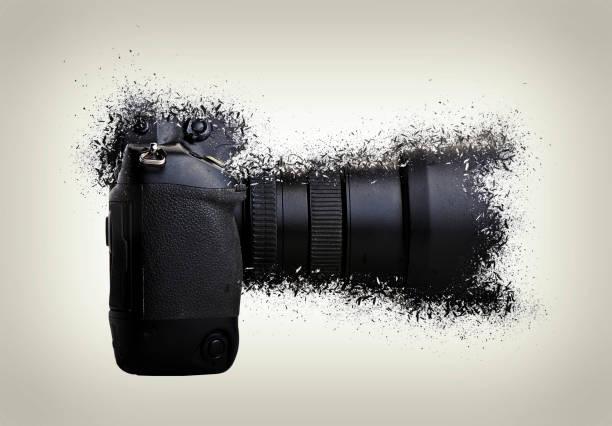 One black camera shattered stock photo