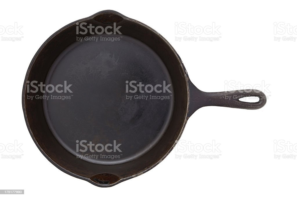 One black cast iron skillet isolated on white stock photo
