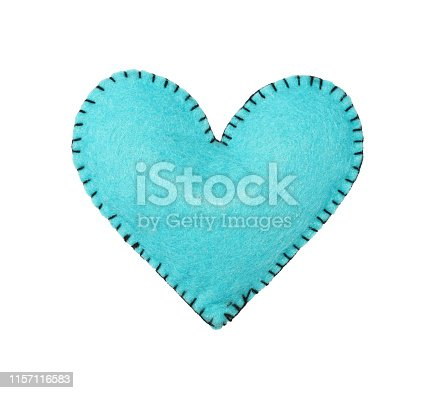 Close up one teal blue felt stitched toy heart isolated on white background