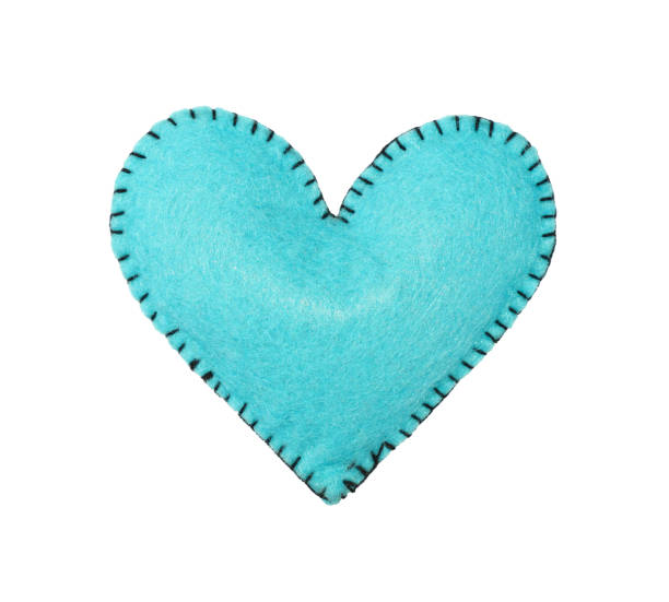One blue felt stitched heart isolated on white Close up one teal blue felt stitched toy heart isolated on white background felt textile stock pictures, royalty-free photos & images