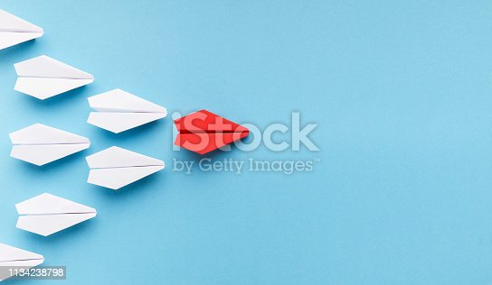 istock One blue paper plane leading group of white ones 1134238798