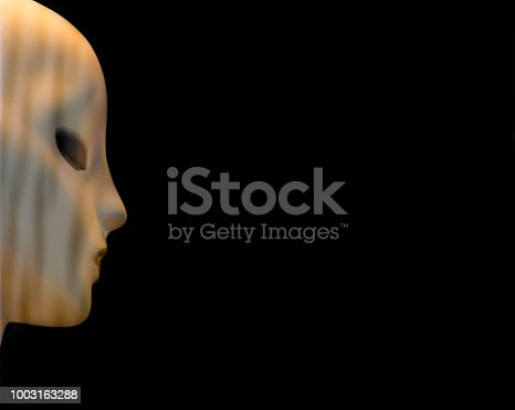 1128821780istockphoto One blurry bold head female robot doll face in profile view against black  background 1003163288