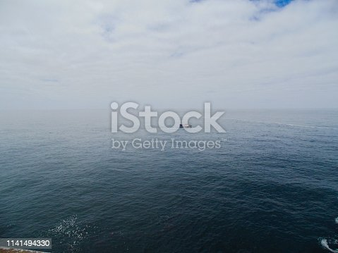 One boat in the middle of the ocean- Cabo Espichel-Portugal