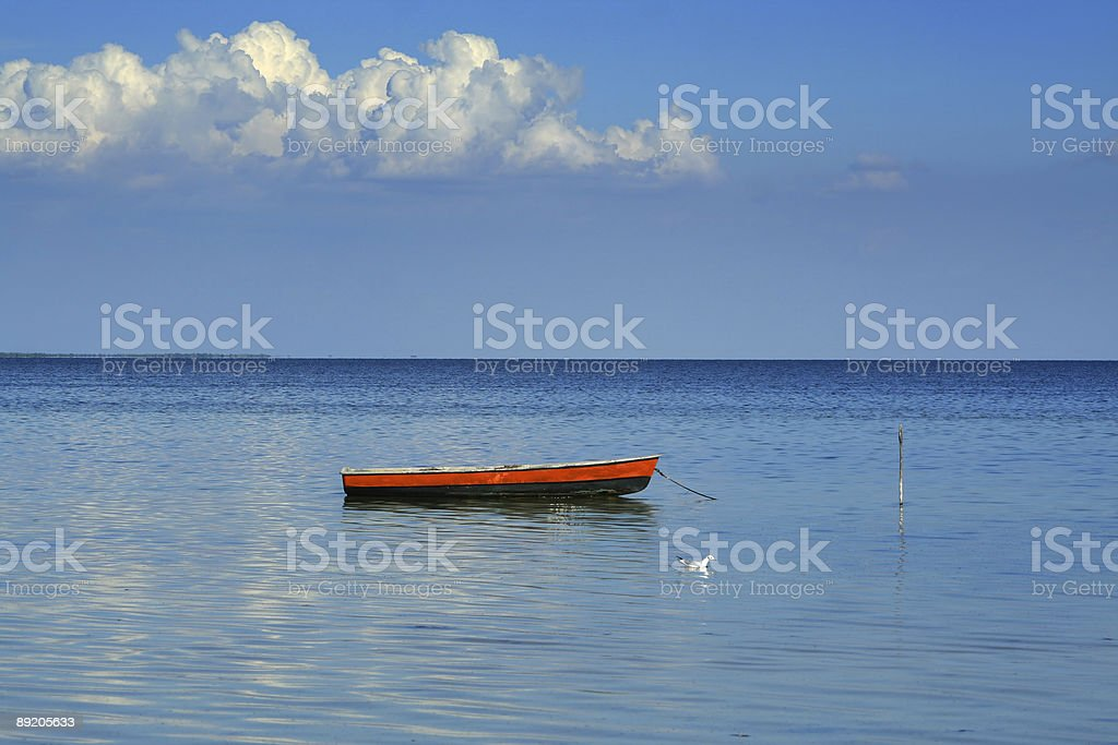 One boat,  seagull and  cloud royalty-free stock photo
