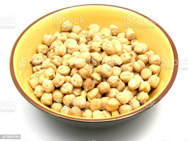 One bowl of ceramic with garbanzos on white