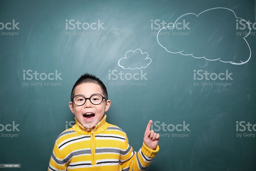 one boy is thinking questions in front of the blackboard royalty-free stock photo