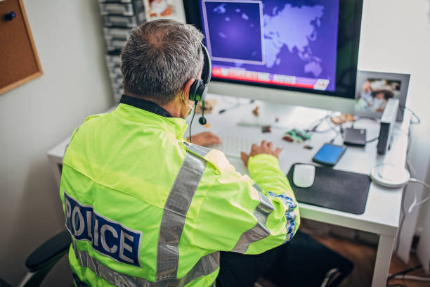 One British police officer with protective mask working hard stock photo