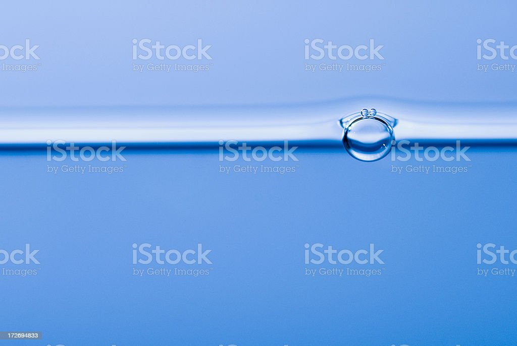 One bubble floating on the water surface in horizontal view royalty-free stock photo