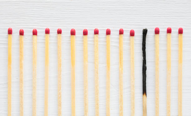 One burned out match in row of fresh ones. Burnout concept. One burned out match in row of fresh ones. Illustration of burnout concept. mental burnout stock pictures, royalty-free photos & images
