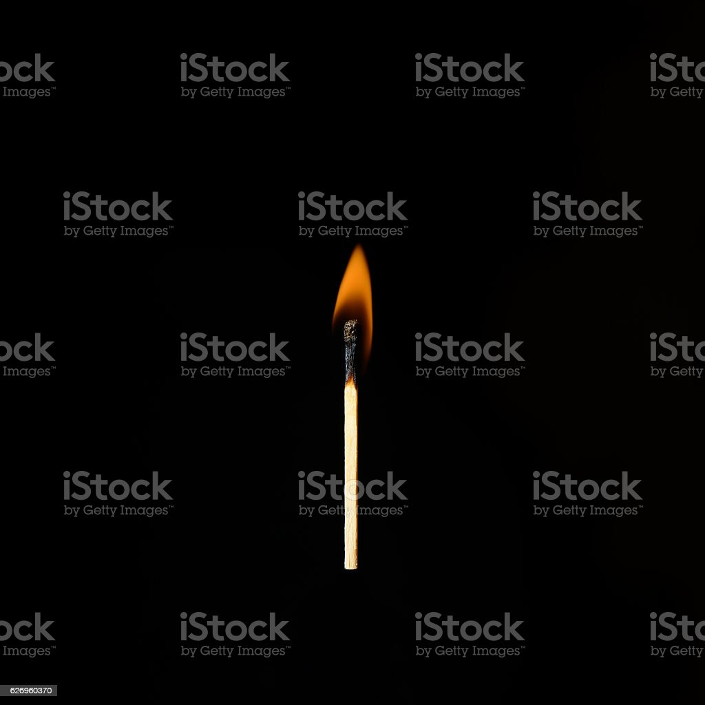 one burning match on a black background – Foto