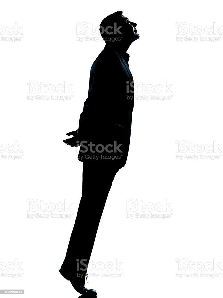 one business man silhouette tiptoe looking up royalty-free stock photo