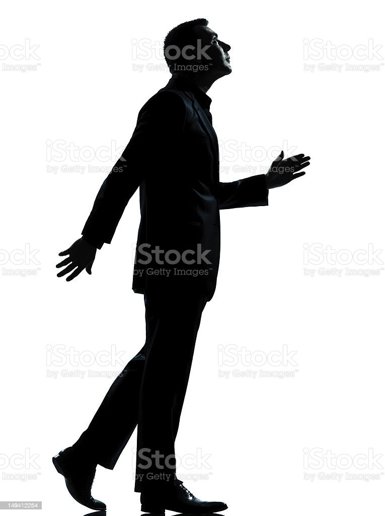 one business man walking looking up silhouette royalty-free stock photo