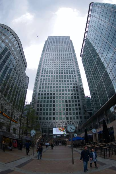 One Canada Square Fish eye view of the iconic Canary Wharf building, with the clocks visible at the base. skeable stock pictures, royalty-free photos & images