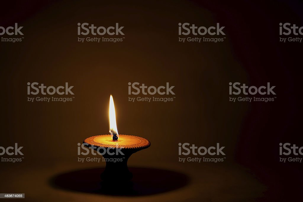 One candle flame at night closeup - isolated stock photo