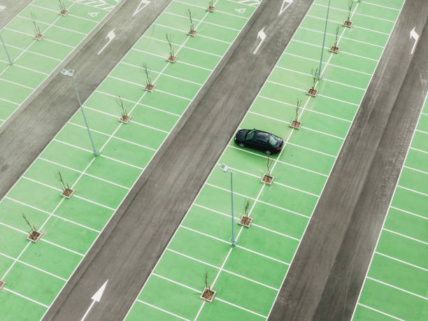 One car in a large parking lot stock photo