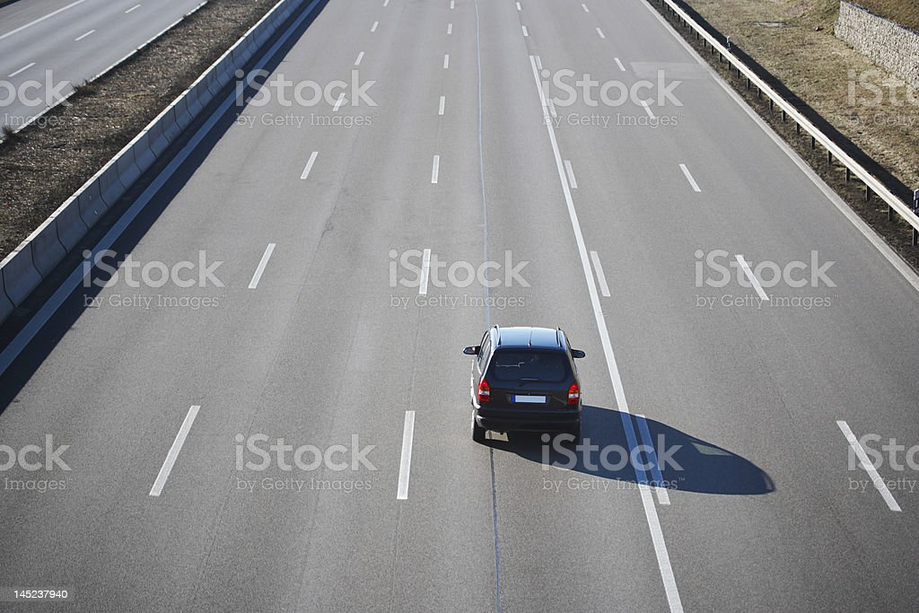 one car on German autobahn, five lanes stock photo