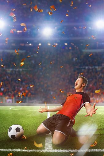 one caucasian soccer player man happy celebration in soccer stadium