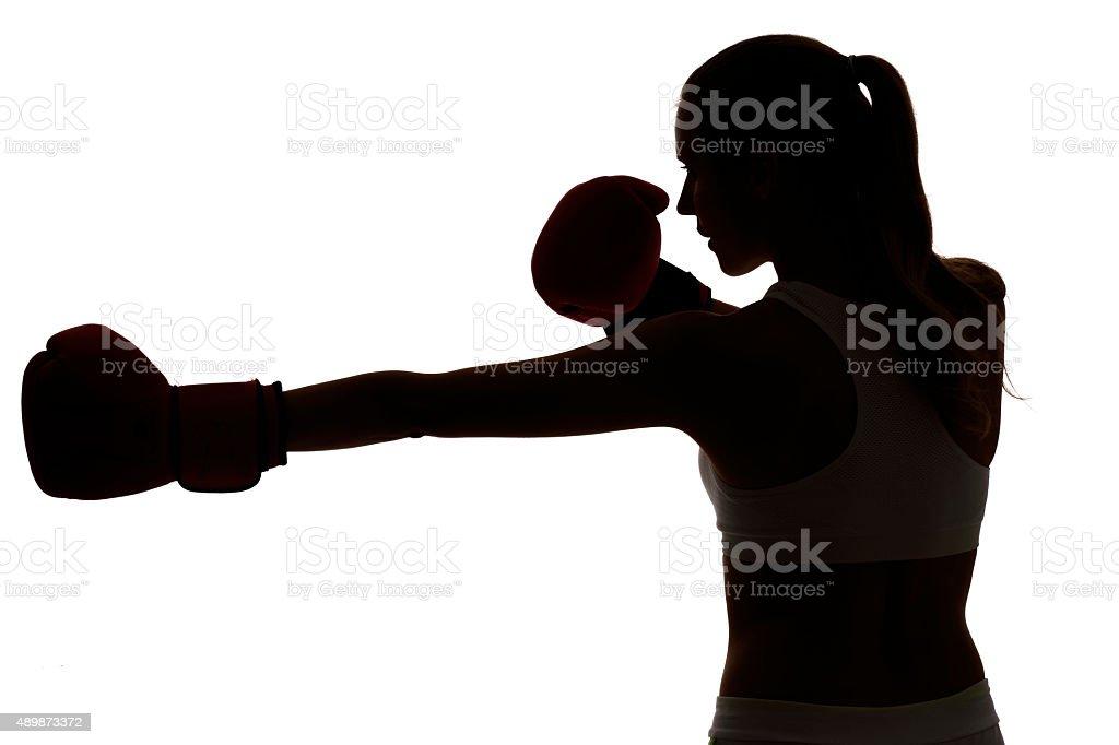 One Caucasian Woman Boxing Exercising In Silhouette Studio