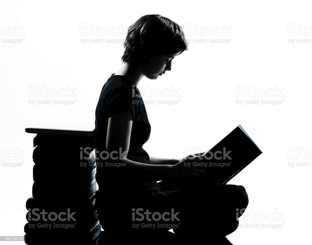one caucasian young teenager silhouette girl reading stock photo