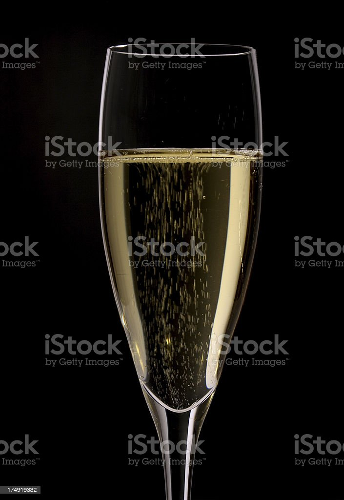 A flute with Champagne on a black background