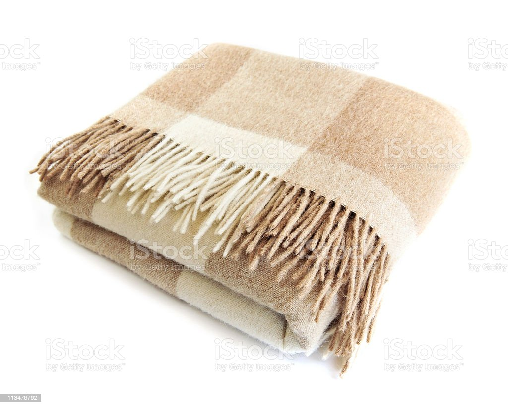 One checkered beige and white alpaca wool blanket stock photo