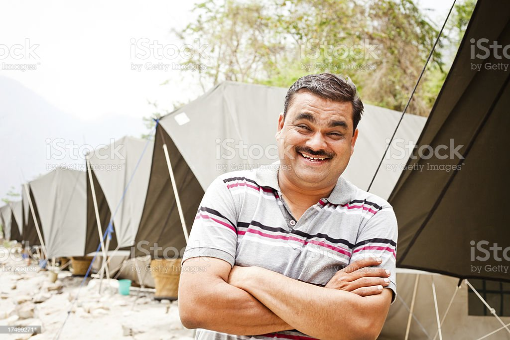 One Cheerful Asian Indian Male at a Camp in Rishikesh royalty-free stock photo