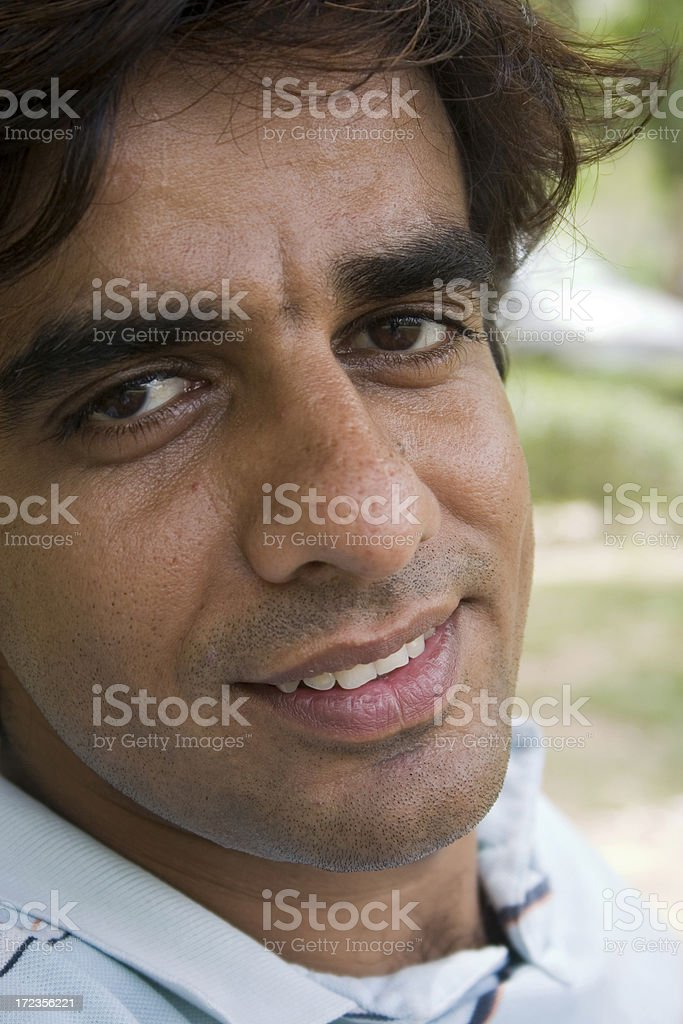 One Cheerful Indian Asian Adult man male smiling People Vertical royalty-free stock photo