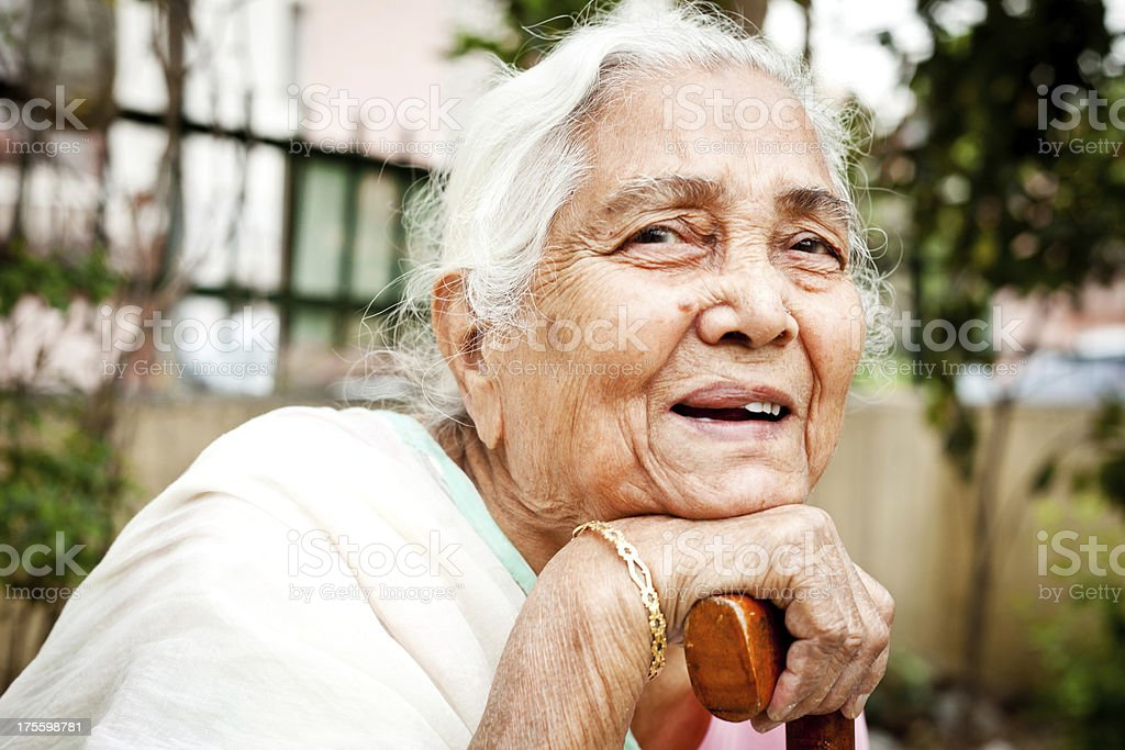 One cheerful senior Indian woman stock photo