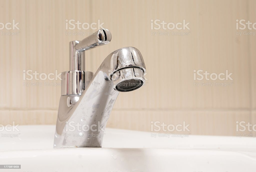 One chrome faucet in washbowl royalty-free stock photo