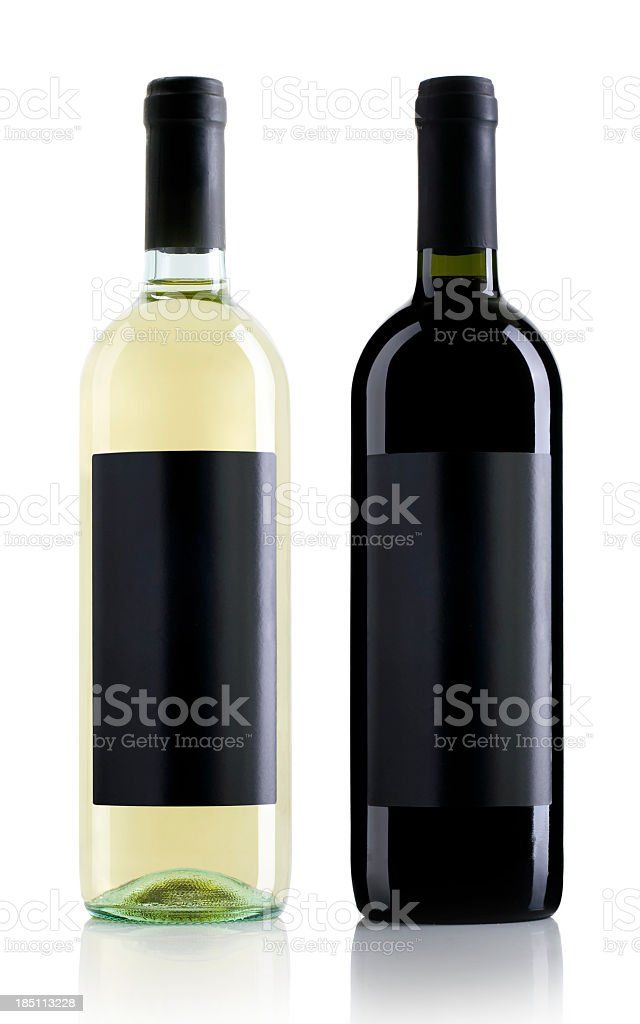 One clear wine bottle and one black wine bottle stock photo