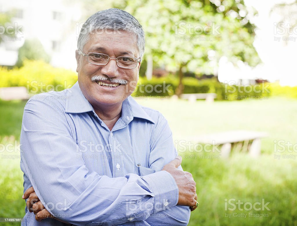 One Confident Handsome Asian Indian Active Mid Adult Senior Man stock photo
