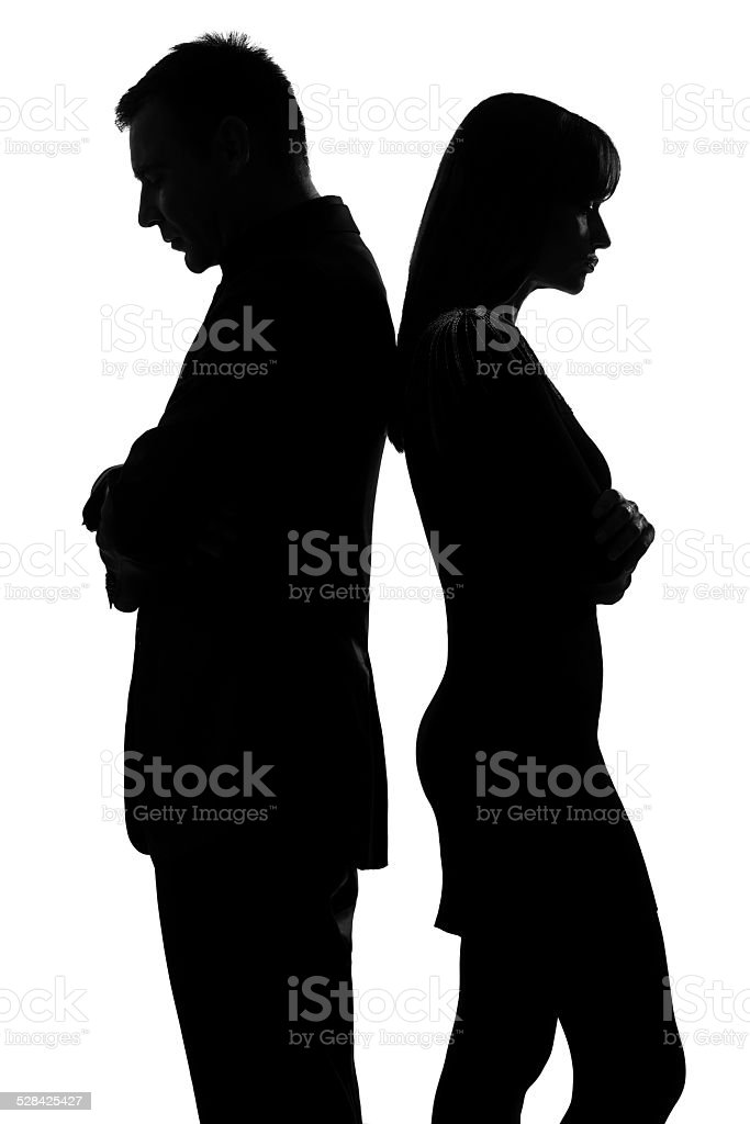 one couple back to back man and woman sad silhouette stock photo