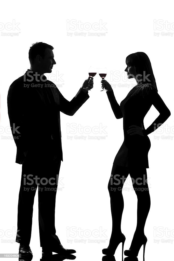 one couple man and woman drinking red wine toasting royalty-free stock photo