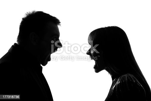 one caucasian couple man and woman face to face screaming shouting dispute in studio silhouette on white background