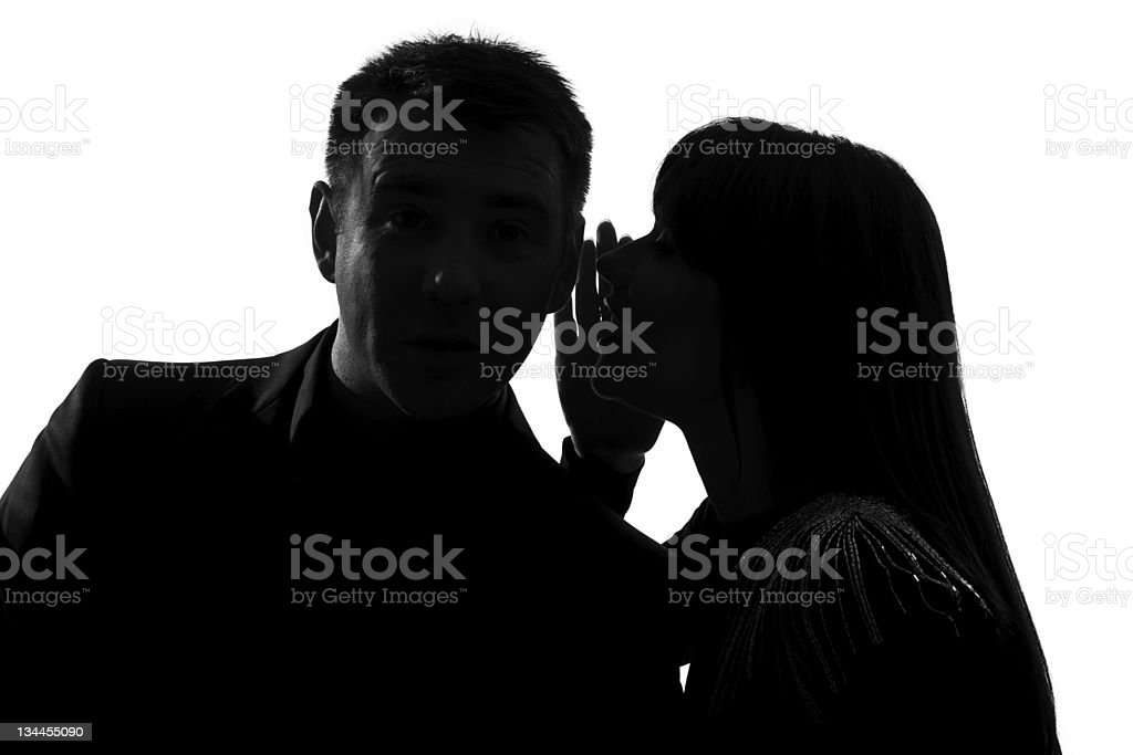 one couple man and woman whispering at ear stock photo