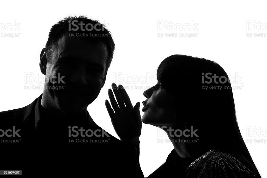 one couple man and woman whispering at ear silhouette stock photo