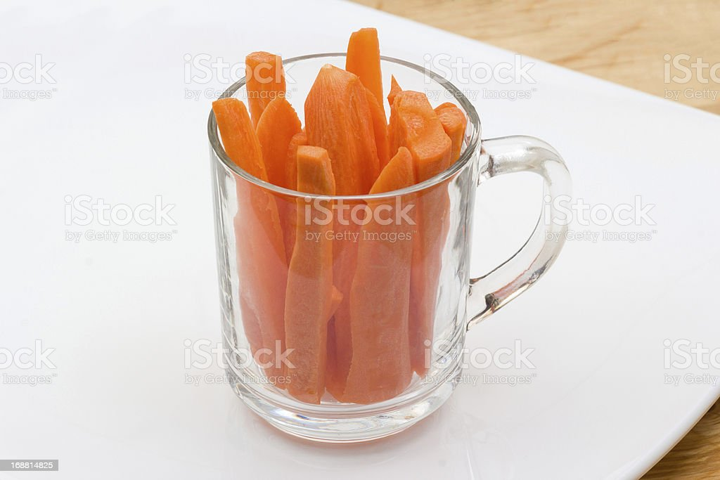 One cup of sliced carrot on white plate royalty-free stock photo