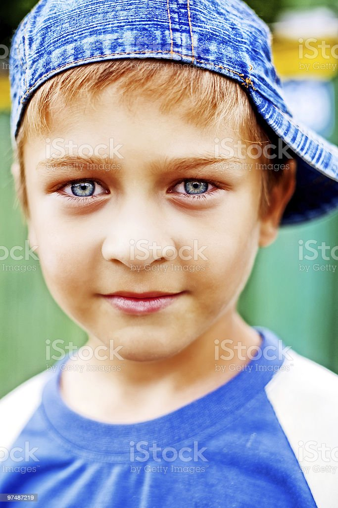 One cute kid with beautiful blue eyes royalty-free stock photo